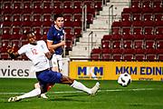 Lewis Morgan Scotland U21s (Celtic FC) gets a shot off past the outstretched leg of Aaron Wan-Bissaka England U21s (Crystal Palace) during the U21 UEFA EUROPEAN CHAMPIONSHIPS match Scotland vs England at Tynecastle Stadium, Edinburgh, Scotland, Tuesday 16 October 2018.
