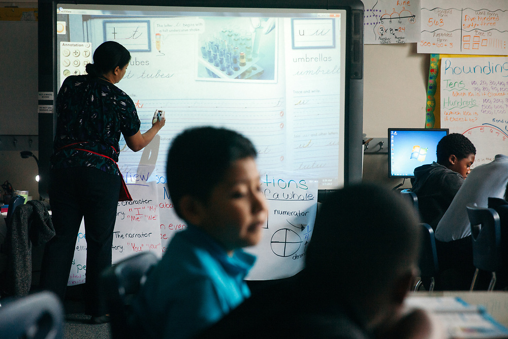"""BIRMINGHAM, AL – MARCH 7, 2017: Third graders at Glen Iris Elementary practice the upstroke during a cursive writing class with Afsaneh Beauvais. Beauvais, an elementary school teacher of three years, believes cursive writing is valuable even in the digital world. """"It's relevant to real life,"""" Beauvais said. """"If nothing else, everybody has to sign their name."""" <br /> <br /> With the adoption of Common Core standards in 2010, school districts have begun to weigh the value of cursive writing compared to modern communication methods favoring laptops, tablets and cell phones. The discipline, once considered an academic rite of passage for young students, is now at risk of being replaced as school districts nationwide weigh the value of cursive writing.<br /> CREDIT: Bob Miller for The Wall Street Journal<br /> CURSIVE"""