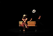 Couple on a park bench at night (stage performance)
