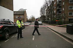 © Licensed to London News Pictures. 10/12/2020. London, UK. Police cordon outside Stoke Newington School & Sixth Form in Hackney, north London, after the school was evacuated following a bomb threat. Police were contacted by staff at 11.55am on Thursday afters school received a bomb threat. Pupils were evacuated and officers are at the scene. Photo credit: Dinendra Haria/LNP
