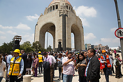 People evacuated from office buildings during the earthquake gathered on TheMonumentto theRevolution in Mexico City, Mexico on September 19, 2017. The 7.1 magnitude earthquake rocked Central Mexico, killing dozens people and causing serious damage to buildings in the capital. The worst earthquake in the history of Mexico occurred on September 19, 1985, killing nearly 10,000 people. (Photo by Bénédicte Desrus/Sipa USA)