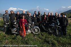 A Nepalese woman joins our group as we posed with a spectacular background of 23,000' peaks on day-4 our our Himalayan Heroes adventure riding from Pokhara to Kalopani, Nepal. Friday, November 9, 2018. Photography ©2018 Michael Lichter.