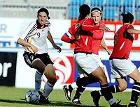 Fotball<br /> Landskamp kvinner<br /> Norge v Tyskland 2-0<br /> 23.07.2008<br /> Foto: Eirik Førde, Digitalsport<br /> <br /> Birgit Prinz surrounded by tre norwegian defenders during the  match between Norway and Germany at the xxx stadium  on July 23, 2008 in Sandefjord, Norway<br /> <br /> GERMANY OUT