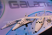 Scale model of Virgin Galactic's WhiteKnightTwo space vehicle with SpaceShipTwo in the middle at air show PR event.