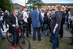 © Licensed to London News Pictures . 22/05/2019. Salford, UK. A man who says he reports for Breitbart News appears covered in milkshake and reports being covered in the dairy-based beverage by an anti-fascist protester whilst conducting interviews at the rally . Former EDL leader Stephen Yaxley-Lennon (aka Tommy Robinson ) holds a campaign rally at the derelict Mocha Parade shopping precinct in Salford , opposed by anti-fascists . Yaxley-Lennon is running for a seat in the European Parliament representing the North West of England . Photo credit: Joel Goodman/LNP