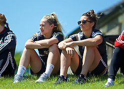 CARDIFF, WALES - Thursday, June 2, 2016: Wales women's players Charlie Estcourt and Nia Jones watch the men's senior team during a training session at the Vale Resort Hotel ahead of the International Friendly match against Sweden. (Pic by David Rawcliffe/Propaganda)