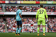 Tyrone Mings of AFC Bournemouth argues with Bournemouth goalkeeper Asmir Begovic who holds a punctured burst football in his hand. Premier league match, Arsenal v AFC Bournemouth at the Emirates Stadium in London on Saturday 9th September 2017. pic by Kieran Clarke, Andrew Orchard sports photography.