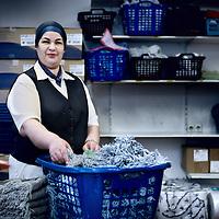 Nederland, Amsterdam , 4 januari 2012..Khadija Tahiri-Hyati, president van het Parlement van de Schoonmakers, die morgen in Amsterdam gaat staken..Khadija is hier gefotografeerd in de wasruimte van Boven-IJ ziekenhuis. ..Foto:Jean-Pierre Jans