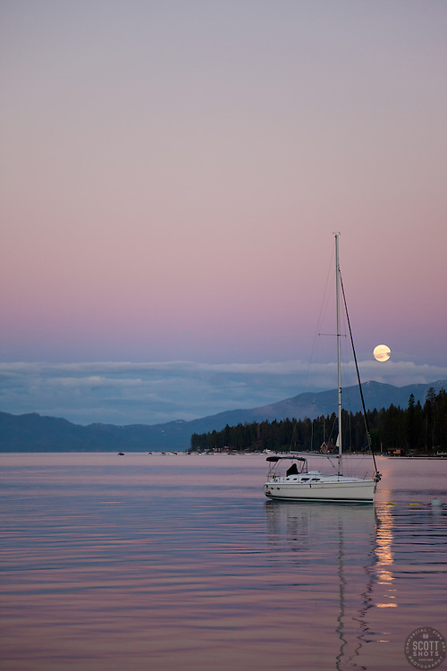 """""""Lake Tahoe Full Moon Sunset 1"""" - This sailboat, full moon, and sunset were photographed from Obexer's Marina, Lake Tahoe."""