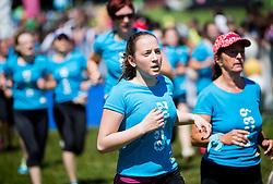 Women during 5km and 10km running race 9. DM Tek za zenske on May 31, 2014 in Tivoli, Ljubljana, Slovenia. Photo by Vid Ponikvar / Sportida