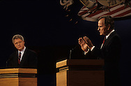 President Hubert Walker Bush and candidate Bill Clinton at the first presidential debate of the 1992 election. ..Photograph by Dennis Brack bb24