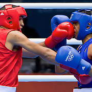 Vasyl Lomachenko of Ukraine, left, in red, the top seed in the men's light 60kg division, punched Wellington Arias Romero of Dominican Republic at the ExCel centre during the 2012 Summer Olympic Games in London, England, Thursday, August 2, 2012. Lomachenko won the bout, 15-3.(David Eulitt/Kansas City Star/MCT)