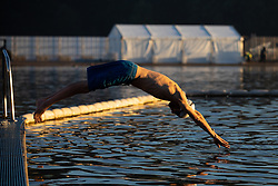 © Licensed to London News Pictures. 27/09/2018. London, UK. A swimmer enters the Serpentine Lido in Hyde Park at sunrise this morning. The temperature in the capital is set to reach 22 degrees Celsius later today. Photo credit : Tom Nicholson/LNP
