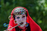 A performer blows bubbles at the Renaissance Fair at Las Golondrinas, New Mexico. USA