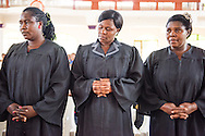 Deaconesses pray during graduation on Saturday, March 14, 2015, at the Evangelical Lutheran Church in Tanzania – South-East of Lake Victoria Diocese's (ELCT-SELVD) Ebenezer Cathedral in Shinyanga, Tanzania.  LCMS Communications/Erik M. Lunsford