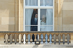 Ivanka Trump and Jared Kushner watch on from a window during the Ceremonial Welcome at Buckingham Palace, London, on day one of his three day state visit to the UK.