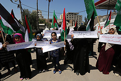 June 18, 2017 - Gaza City, Gaza Strip, Palestinian Territory - Palestinian women take part in a rally in support of Qatar and against the blockade on the Gaza Strip, in front of the Legislative Council in Gaza city on June 18, 2017  (Credit Image: © Ashraf Amra/APA Images via ZUMA Wire)