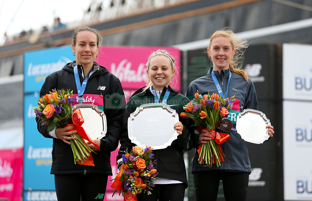 Charlotte Purdue, winner of the women's race (centre), with Charlotte Arter in third (right) and Beth Twell in second during the Vitality Big Half in London.