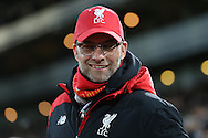 Jürgen Klopp, the Liverpool manager smiling as he arrives at the dugout before k/o. The Emirates FA cup, 4th round replay match, West Ham Utd v Liverpool at the Boleyn Ground, Upton Park  in London on Tuesday 9th February 2016.<br /> pic by John Patrick Fletcher, Andrew Orchard sports photography.
