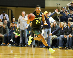 Jan 9, 2018; Morgantown, WV, USA; Baylor Bears guard King McClure (22) dribbles the ball during the first half against the West Virginia Mountaineers at WVU Coliseum. Mandatory Credit: Ben Queen-USA TODAY Sports