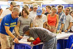 Meb Keflezighi signs autographs