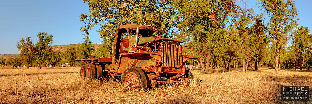 An old truck wreck in a paddock in the Kimberleys of Western Australia<br /> <br /> Code: HAWK0020<br /> <br /> Open Edition Print / Stock Image