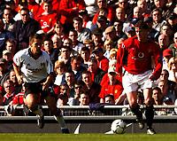 Photo. Javier Garcia<br />22/03/2003 Man United v Fulham, FA Barclaycard Premiership, Old Trafford<br />Ole Gunnar Solksjaer gets around Jon Harley
