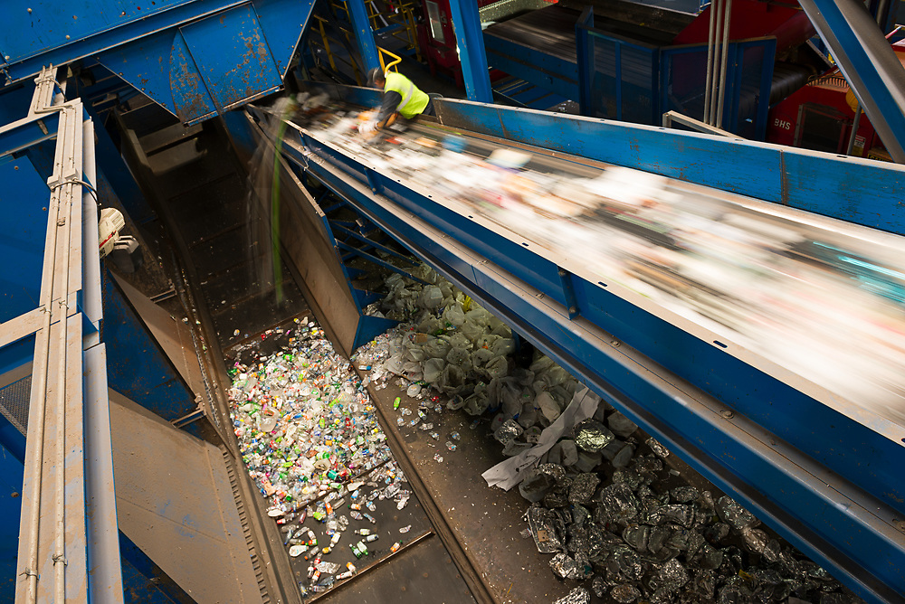 A sorter snatches valuable metals and plastics from a stream of waste.