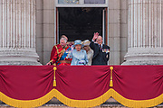 """The Royal Family gathers on the balcony for the flypast and cheers from the crowd - Trooping the Colour by the Irish Guards on the Queen's Birthday Parade. The Queen's Colour is """"Trooped"""" in front of Her Majesty The Queen and all the Royal Colonels.  His Royal Highness The Duke of Cambridge takes the Colonel's Review for the first time on Horse Guards Parade riding his horse Wellesley. The Irish Guards are led out by their famous wolfhound mascot Domhnall and more than one thousand Household Division soldiers perform their ceremonial duty. The Soldiers will parade in the traditional ceremonial uniforms of the Household Cavalry, Royal Horse Artillery, and Foot Guards. They are accompanied by the Household Division Bands & Corps of Drums. London 17th June 2017."""