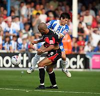 Photo: Chris Ratcliffe.<br />Colchester United v Queens Park Rangers. Coca Cola Championship. 16/09/2006.<br />Zesh Rehman (L) of QPR clashes with Kem Izzet of Colchester United.