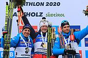 Men 15 Km medalist  Quentin Fillon Maillet (FRA), Johannes Thingnes Boe (NOR)a and Emilien Jacquelin (FRA) pose at the IBU Biathlon World Championships, Sunday, Feb. 23, 2020, in Antholtz-Anterselva, Italy. (Pierre Teyessot-ESPA-Images/Image of Sport)