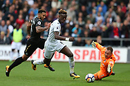 Tammy Abraham of Swansea city goes past Newcastle Utd goalkeeper Rob Elliot but fails  to score in the 2nd half.  Premier league match, Swansea city v Newcastle Utd at the Liberty Stadium in Swansea, South Wales on Sunday 10th September 2017.<br /> pic by  Andrew Orchard, Andrew Orchard sports photography.