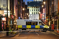 © Licensed to London News Pictures. 03/02/2020. LONDON, UK. A police van parked at Old Compton Street and Dean Street intersection. Scenes in Soho where the public have been evacuated by police and emergency services are in attendance after reports of an unexploded WW2 bomb being discovered in the area.  A wide cordon has been established from Shaftesbury Avenue, Charing Cross Road and the streets around Old Comption Street.  Photo credit: Stephen Chung/LNP