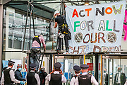 "Police form a line to observe the process of removing a protestors from Police Protest Removal Unit, after a father and ex-teacher climbed onto the canopy above the front door of the Department for Business and Energy building where he spray-painted '4 degrees = Mass murder' and unfurled a banner reading 'Act Now For All Our Children' on Monday, Sept 7, 2020. He said: ""My youngest child is only one. Within her lifetime scientists tell us that we are likely to see 4 degrees of global warming he continued. <br /> Environmental nonviolent activists group Extinction Rebellion enters its 7th day of continuous ten days protests to disrupt political institutions throughout peaceful actions swarming central London into a standoff, demanding that central government obeys and delivers Climate Emergency bill. (VXP Photo/ Vudi Xhymshiti)"