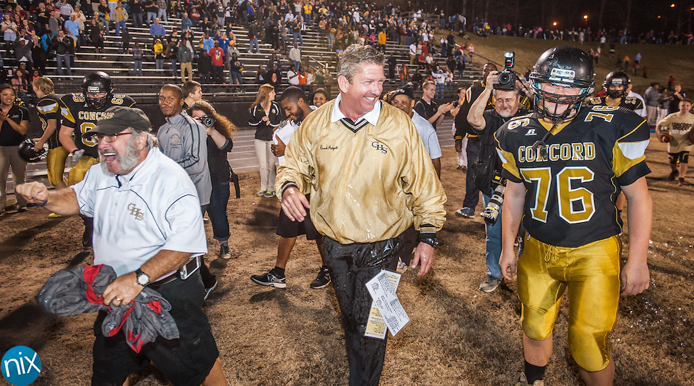 Concord head coach Glen Padgett  celebrates a win against Forestview during the semi finals of the NCHSAA 3A playoffs Friday night at Concord High School. The Spiders defeated Forestview 35-14 to secure a spot in the state championship game.