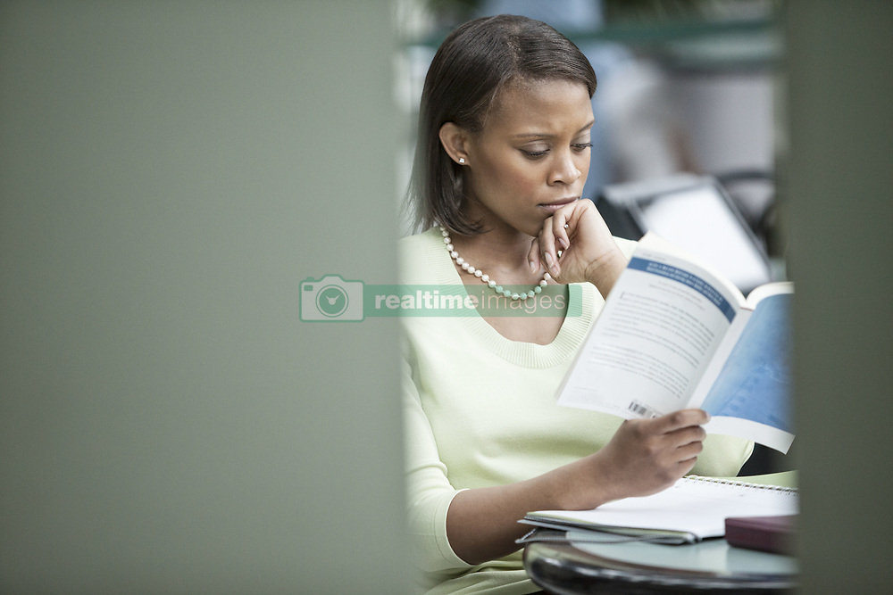 June 17, 2010 - A black businesswoman reading a report. (Credit Image: © Mint Images via ZUMA Wire)