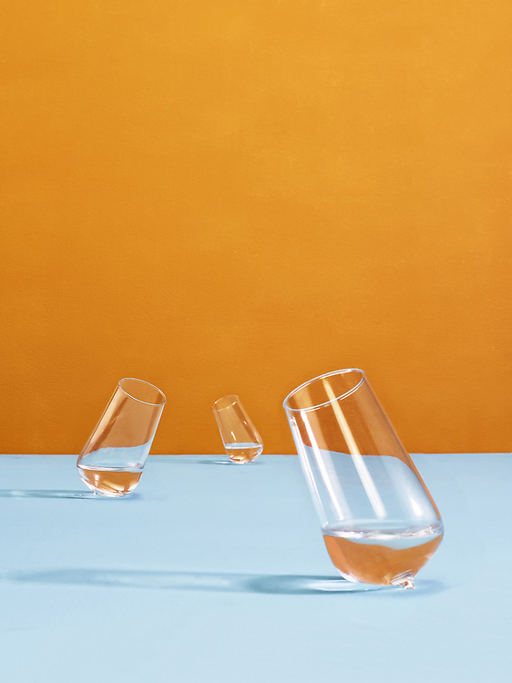 Autonomous art work photographs of still lifes of glasses against a colorfull background. In the series 'In Motion' Ron plays with the reflections of background colors in the clear water filled glasses that seem to move around each other. <br /> <br /> The tranquility of the glasses are symbolising his much clearer view on the emotions, he struggled with in earlier days. <br /> For him, the distortion of the background, is a form to show how often our emotions are changing our way in which we see the world around us. In how we act to each other and moving away from ourselves so often. <br /> <br /> Again the strong use of colors is giving the pictures a certain power and vulnerability. <br /> <br /> These series is represented by ART gogo Shanghai and SBK Amsterdam and you can contact Ron for ordering the print on Canson fine art paper mount on 3 mm dibond in edition of 7