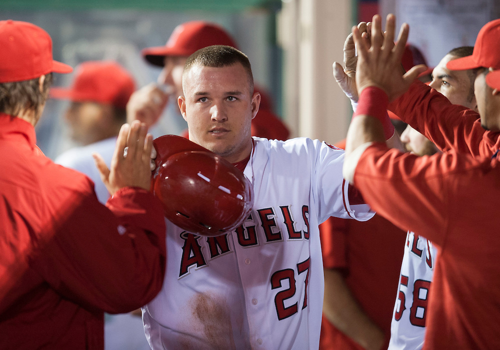 The Angels Mike Trout is welcomed into the dugout after scoring on an error by the Cardinals Stephen Piscotty during the fifth inning against the St. Louis Cardinals Thursday at Angel Stadium.<br /> <br /> ADDITIONAL INFO:   <br /> <br /> angels.0405.kjs  ---  Photo by KEVIN SULLIVAN / Orange County Register  -- 5/12/16<br /> <br /> The Los Angeles Angels take on the St. Louis Cardinals Thursday at Angel Stadium.