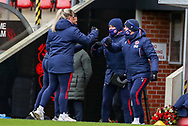 Reading staff celebrate at the final whistle during the FA Women's Super League match between Manchester United Women and Reading LFC at Leigh Sports Village, Leigh, United Kingdom on 7 February 2021.