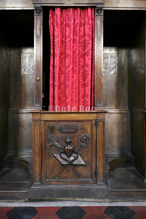 close up of a confession box with priest curtain almost closed