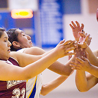 020713       Cable Hoover<br /> <br /> Zuni Thunderbird Tamara Homer (33) and Rehoboth Lynx Taylor Begay (33) and others compete for a rebound Thursday at Zuni High School.