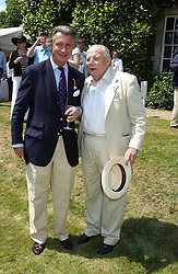 "Left to right, MON.ARNAUD BAMBERGER and The DUKE OF RICHMOND & GORDON at a luncheon hosted by Cartier at the 2005 Goodwood Festival of Speed on 26th June 2005.  Cartier sponsored the ""Style Et Luxe' for vintage cars on the final day of this annual event at Goodwood House, West Sussex. <br />