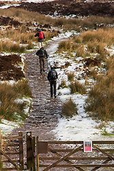 © Licensed to London News Pictures. 12/03/2020. Brecon Beacons, Powys, Wales, UK.  Hikers set off in bitterly cold conditions towards Pen-Y-Fan, the highest summit  in the Brecon Beacons National Park, Powys, Wales, UK. after snow fell on high land in Powys last night. Photo credit: Graham M. Lawrence/LNP