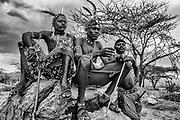 A portrait of Samburu warriors on a rock, black and white,,Samburu, Kenya, Africa