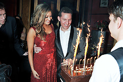 HOLLY VALANCE and NICK CANDY with a Birthday cake at the 39th birthday party for Nick Candy in association with Ciroc Vodka held at 5 Cavindish Square, London on 21st Januatu 2012.