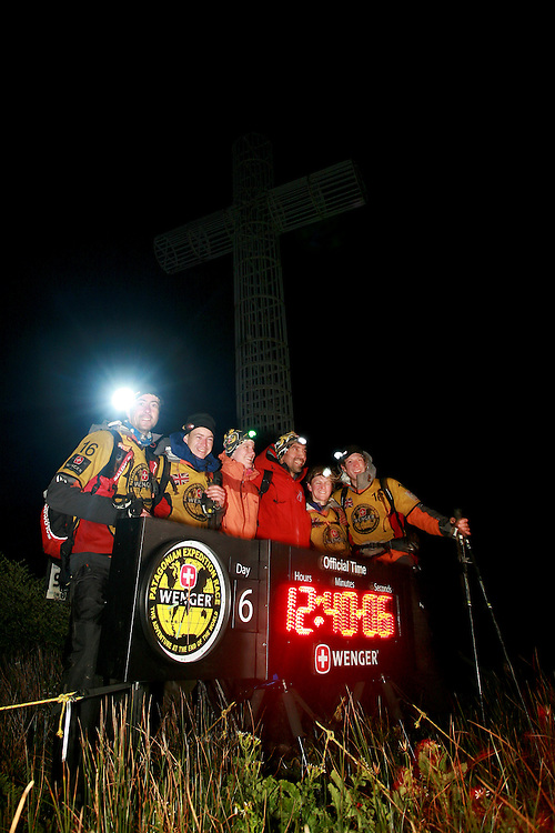 The British Team at the finish of the Wenger Patagonian Expedition Race at the Cross at the End of the World, Capo Forward, Patagonia, Chile South America. L to R Andy Wilson, Mark Humphrey, Nicola Macleod, Bruce Duncan with event organisers Ann Meidinger and Stjepan Pavicic..Copyrighted work .Permission must be sought before use of this image..Alex Ekins .0114 2630277.07901883 994