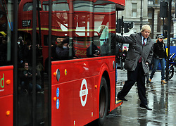 © Licensed to London News Pictures. 16/12/2011, London, UK.  BORIS JOHNSON exits the bus. The first bus designed specifically for London arrived in the capital today, carrying the Mayor of London BORIS JOHNSON. The bus design is based on the famous red route master buses with a rear platform for access. Photo credit : Stephen Simpson/LNP