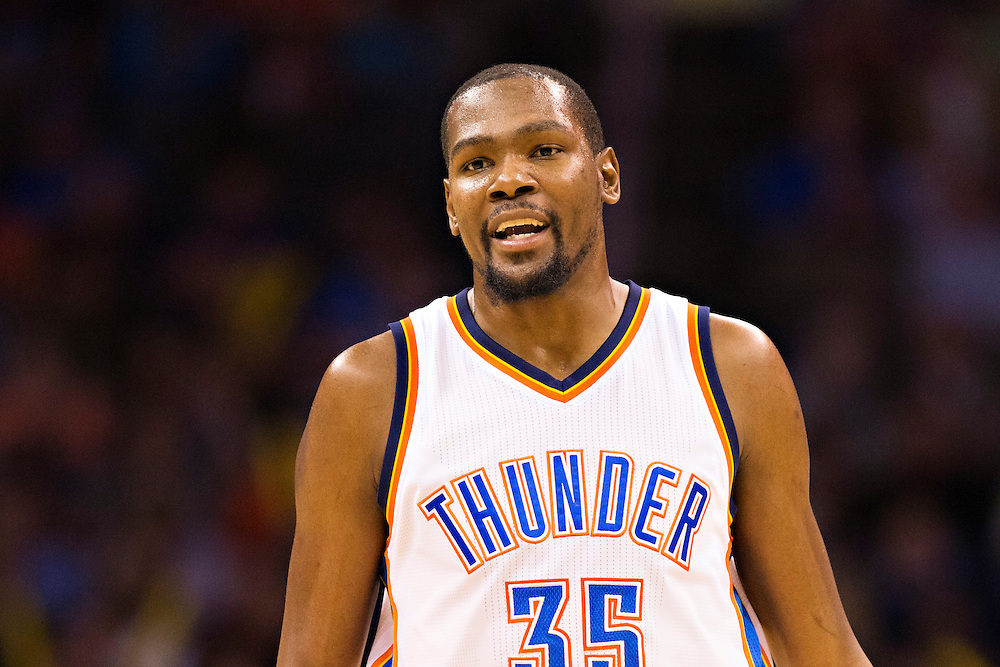 OKLAHOMA CITY, OK - JANUARY 13:  Kevin Durant #35 of the Oklahoma City Thunder talks with a teammate  during a game against the Dallas Mavericks at Chesapeake Energy Arena on January 13, 2016 in Oklahoma City, Oklahoma.  NOTE TO USER: User expressly acknowledges and agrees that, by downloading and or using this photograph, User is consenting to the terms and conditions of the Getty Images License Agreement.   The Thunder defeated the Mavericks 108-89.  (Photo by Wesley Hitt/Getty Images) *** Local Caption *** Kevin Durant