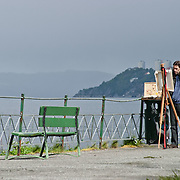 Three weeks aboard the Kong Harald. Hurtigruten, the Coastal Express. Bergen. A painter along the shore of Bergen.