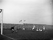 17/03/1960<br /> 03/17/1960<br /> 17 March 1960<br /> Soccer: League of Ireland v Hessen Football Association at Dalymount Park, Dublin.<br /> Hessian Goalie Leichum goes for the ball to stop Hamilton's shot, as Hale (Ireland) closes in from the right. .